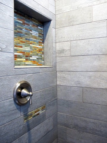 Wood planking tile shower with decorative accents by Dal Tile