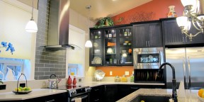 Cambria Bradshaw quartz Caesarstone Linen orange wall stainless steel appliances gormet chef kitchen island pendant lights range hood glass tile 3x12 Earth Glass Graphite statements