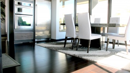 Hardwood floors modern contemporary light bright dining kitchen room windows stainless steel parsons chair