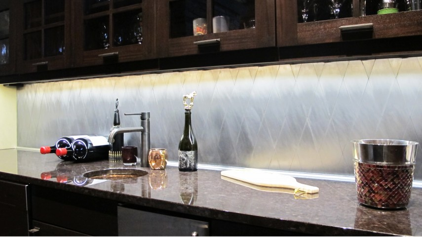 Bar Backsplash with under cabinet lighting recycled metal tile rhomboid wine storage solid surface countertop