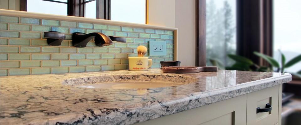 master vanity cambria countertop Praa Sands undermount sink backsplash Boyce and Bean 1x3 offset in Aquatic Antique bronze fixtures