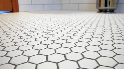 White hexagon 1 inch tiles with pewter grout