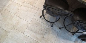 surface art assisi reale 18x18 12x12 pinwheel pattern travertine porcelain tile floors bar stools beige tan khaki installation