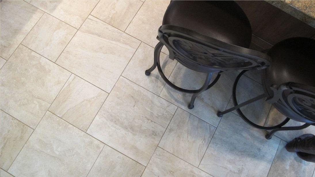 surface art assisi reale 18x18 12x12 pinwheel pattern travertine porcelain tile floors bar stools beige tan khaki installation