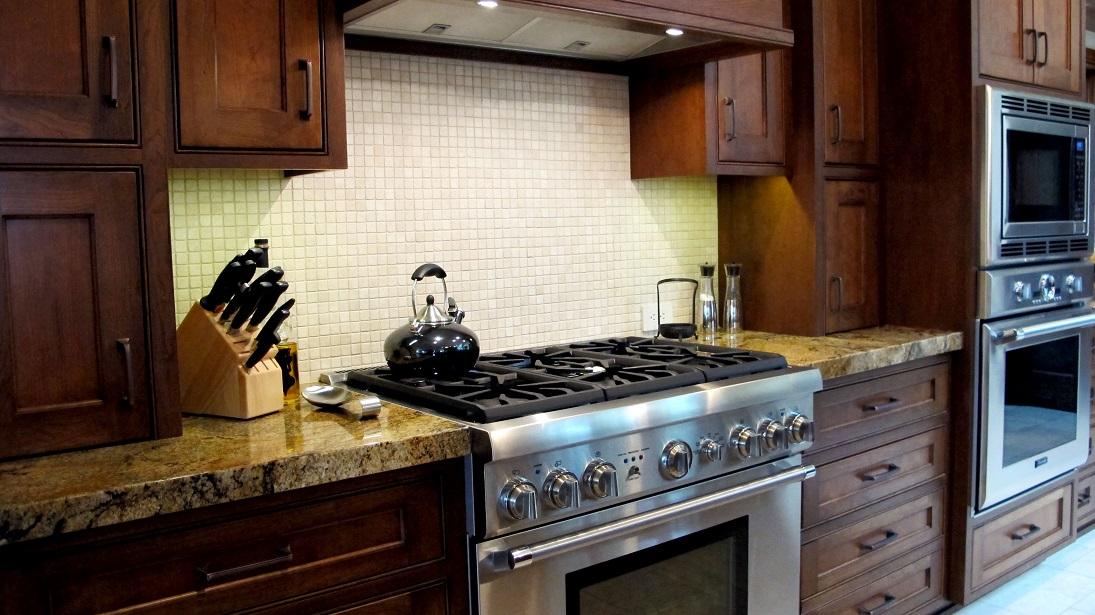 Kitchen traditional backsplash natural stone tumbled travertine mosaic 1x1 sheet light trav beige custom cabinets stainless steel cherry granite countertops gas range