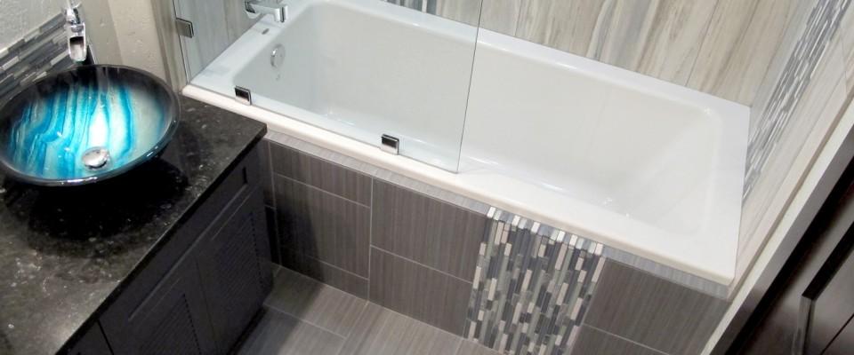 Contemporary modern stylish bathroom guest bath modern vanity vessel sink blue aqua iridescent Flow linear tile porcelain ceramic color body glass mosaics decorative border backsplash cabinets chrome shower tub Thompson Tile Cronin Blends S'tile Sky