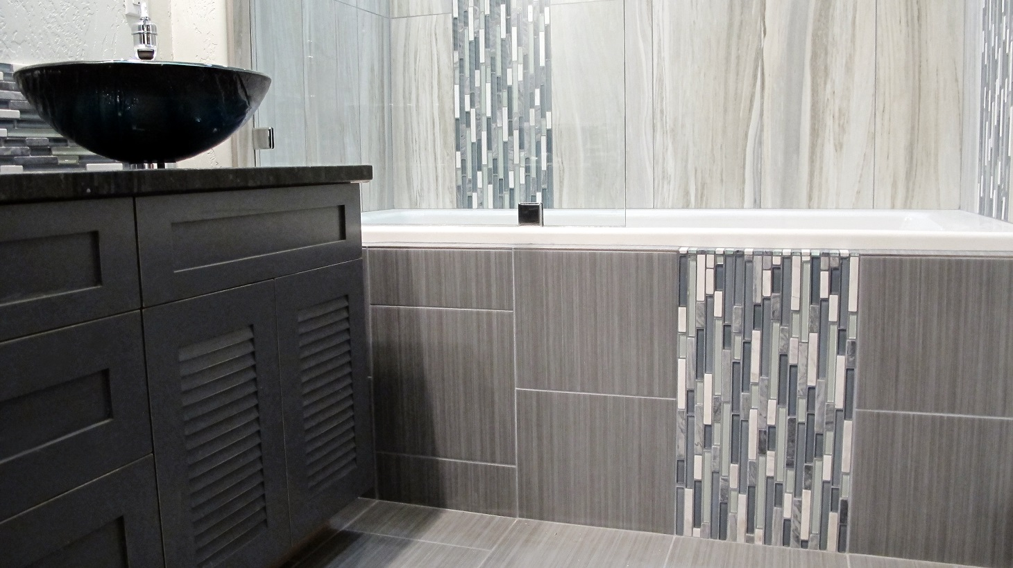 Dark Grey Subway Tile Backsplash Large custom home with porcelain tile and natural stone
