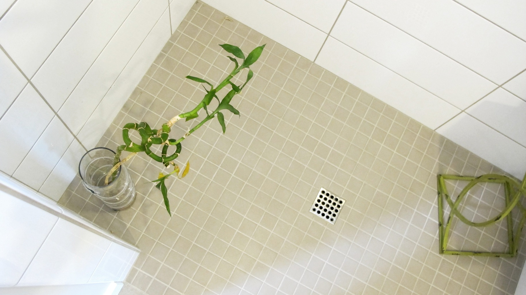 Walk-in shower floor mosaic square drain with Keystone Mosaic in color Uptown Taupe by Daltile Colour & Dimensions subway tile on walls by Thompson Tile in Arctic white