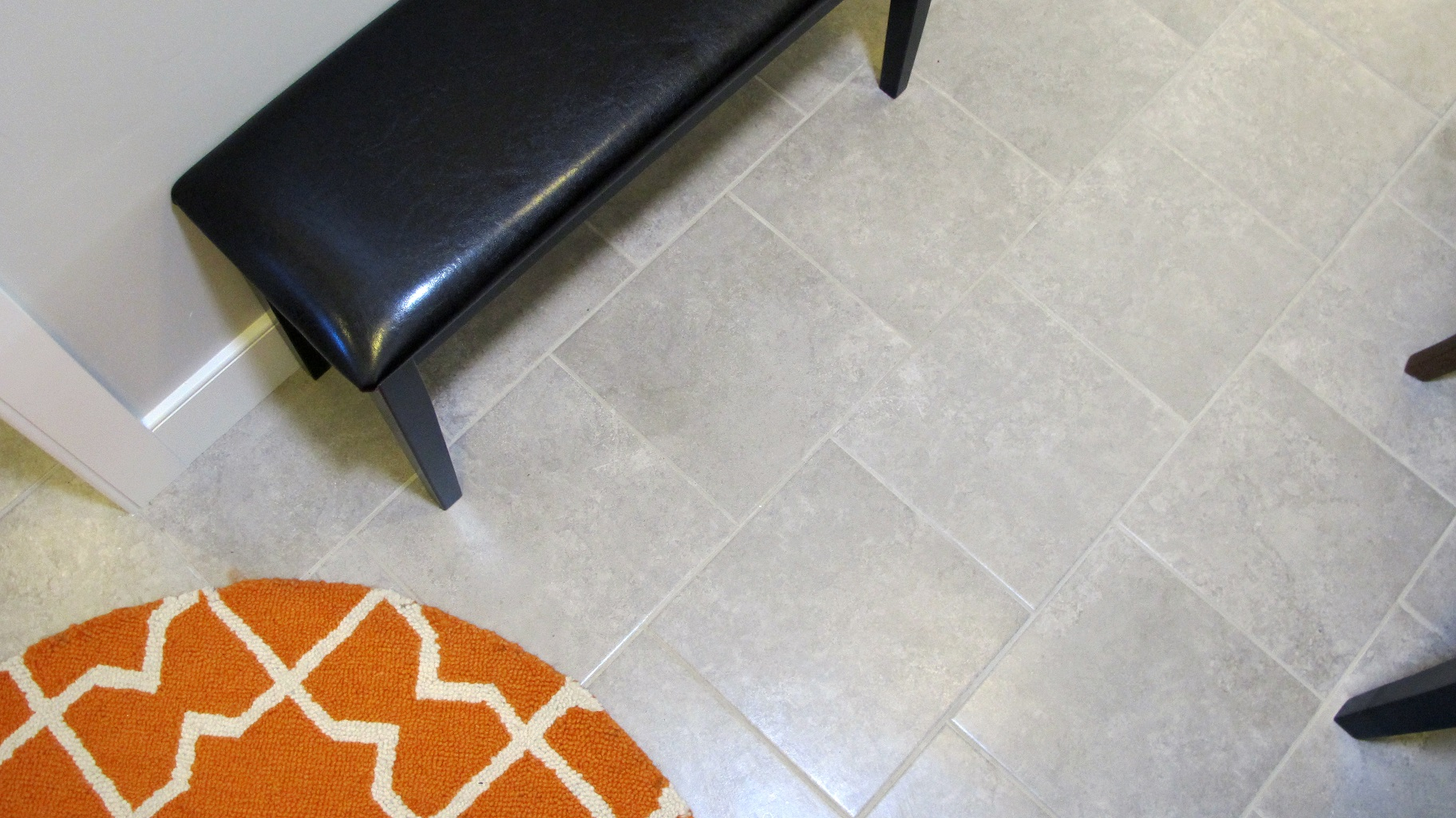 Floor tile Emser Baja 13x13 Tecate porcelain ceramic stagger lay orange decor rug circle black bench gray taupe light contemporary transitional installation