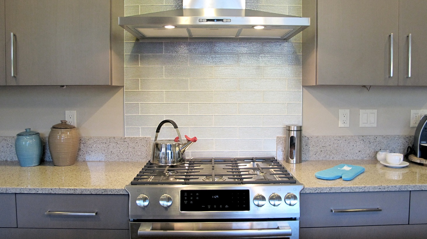 Kitchen back splash glass 3x12 subway stagger white glossy stainless steel range and hood arctic grey cabinets huntwood gas tea kettle quartz lg Viatera