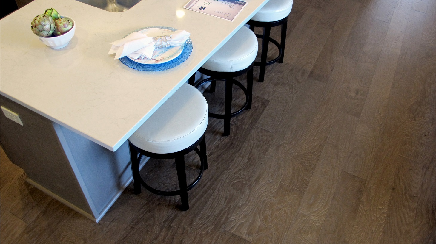Urban loft shaw hardwood floor Long Island color engineered matte finish modern stylish island bar stools quartz counter tops white light bright interior design loft townhouse