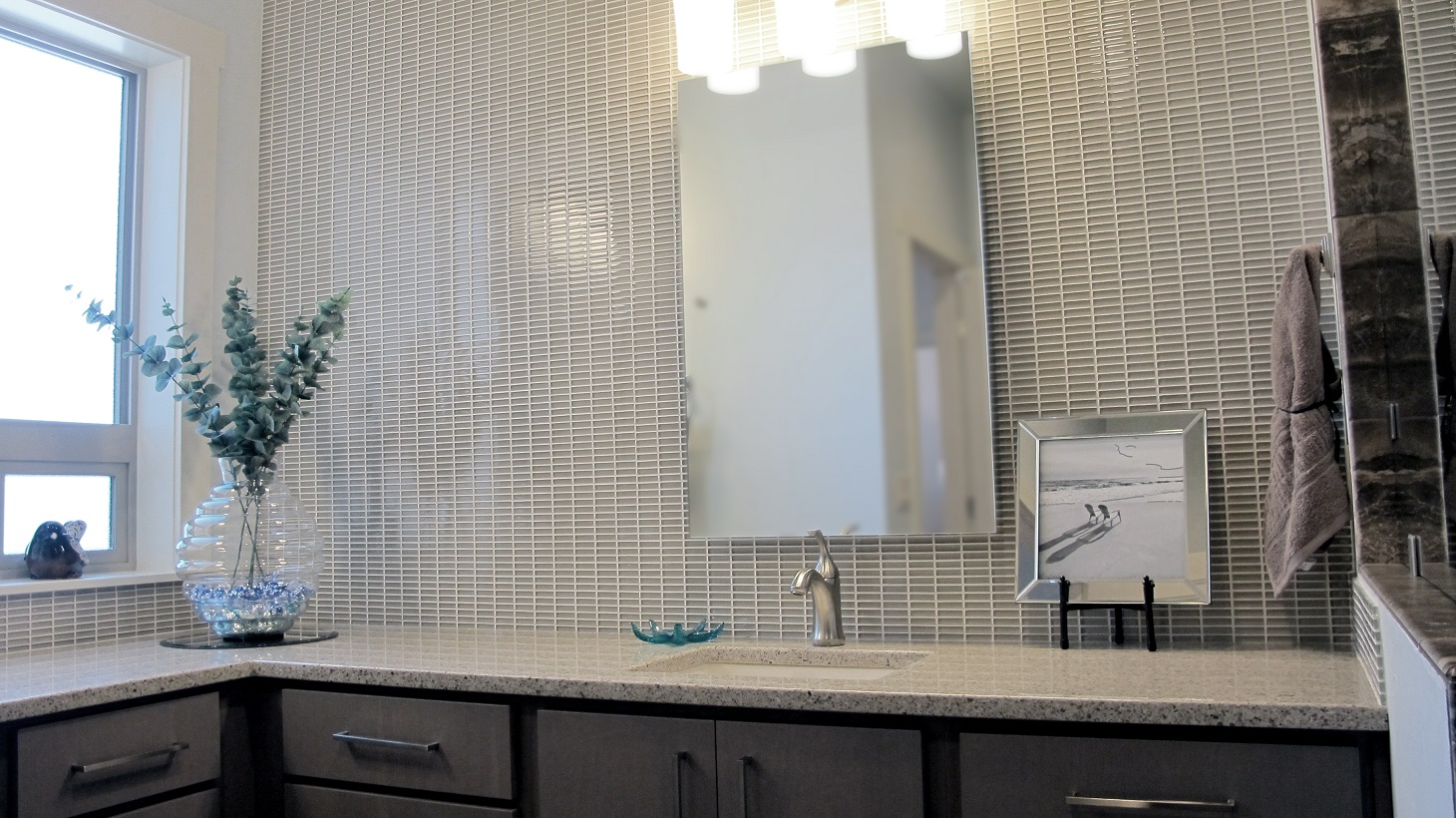 Master bathroom vanity quartz counter top chrome faucet glass mosaic feature wall mirror taupe grey