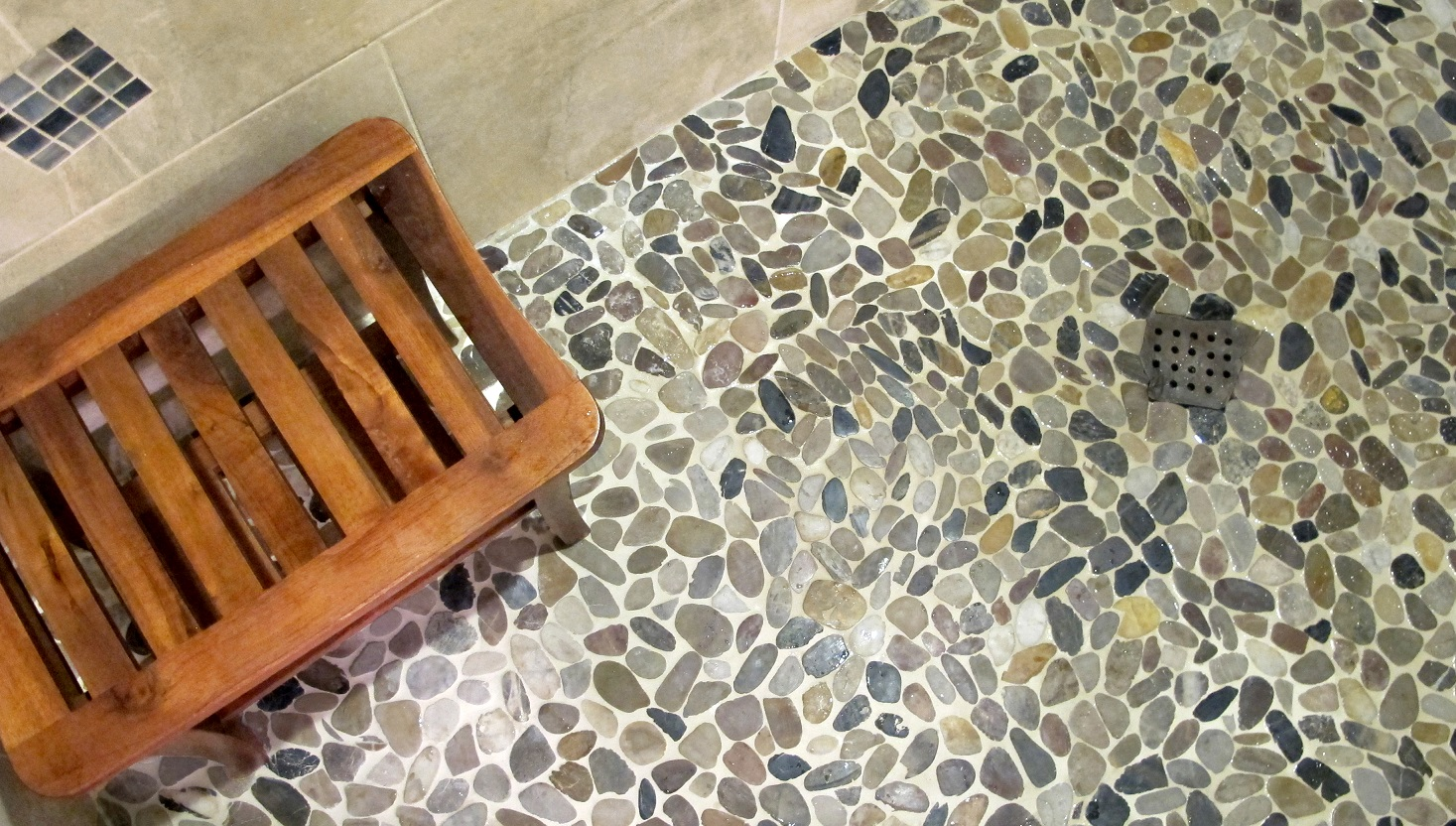 Riviera Pebbles Four Color Blend Emser Tile & Stone drain shower pan custom teak bench flat