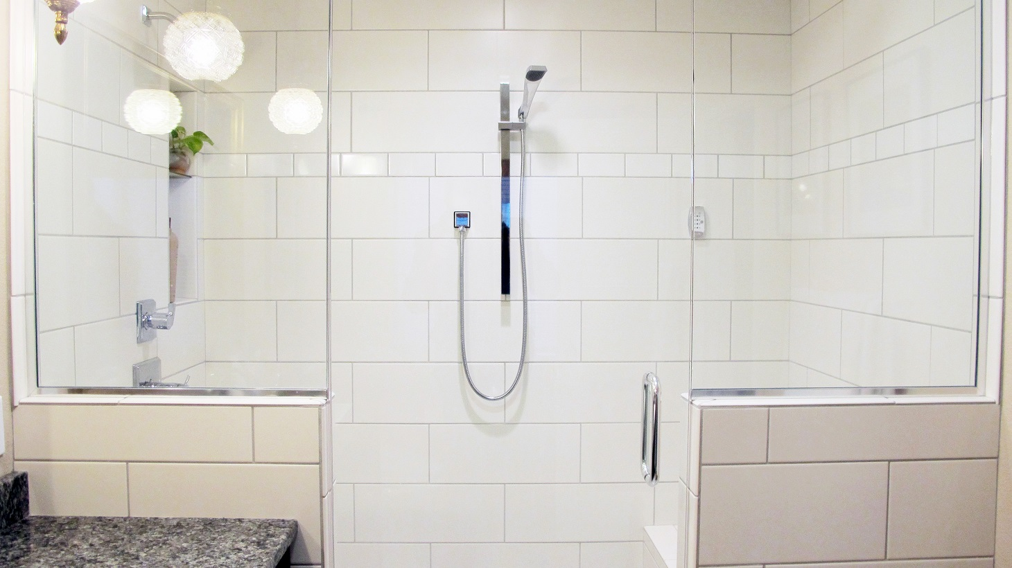 Steam Shower walk in glass enclosed white large format subway tile stagger chrome fixtures pony walls glass enclosed reflection gloss and matte textures ceramic and porcelain tile