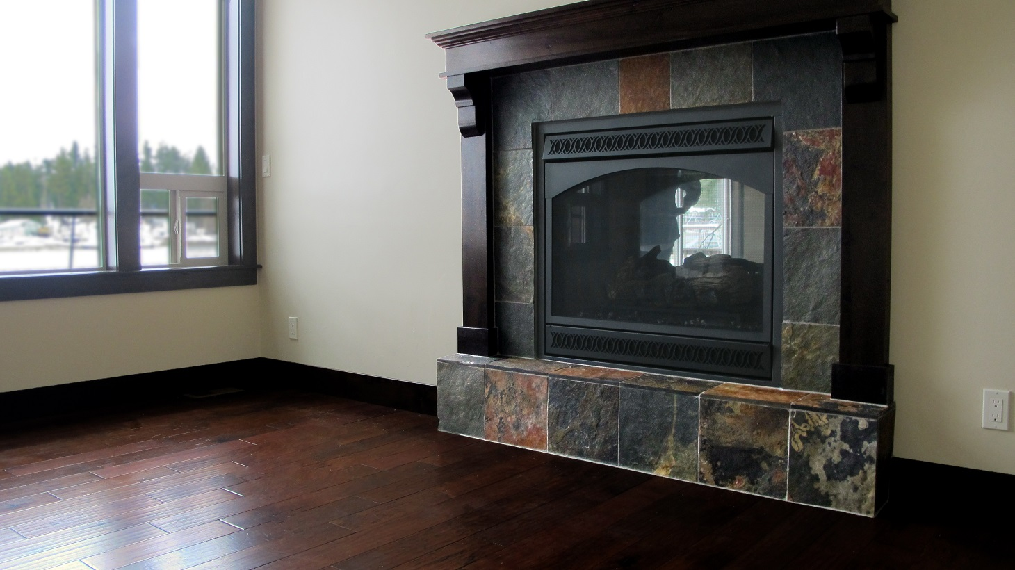 Fireplace hearth raised natural slate espresso wood mantel hardwood flooring Legends Hickory
