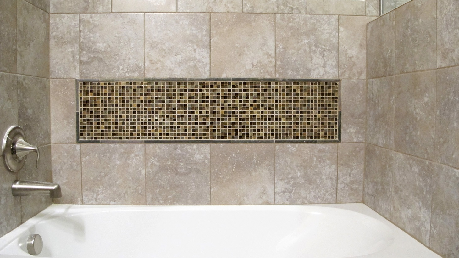 Guest Bathroom slide in bath tub with tile surround and decorative mosaic insert slate glass mix brushed nickel Sandalo Castillian Gray Daltile Stone Radiance Saddle Blend Customs Grout Light Smoke