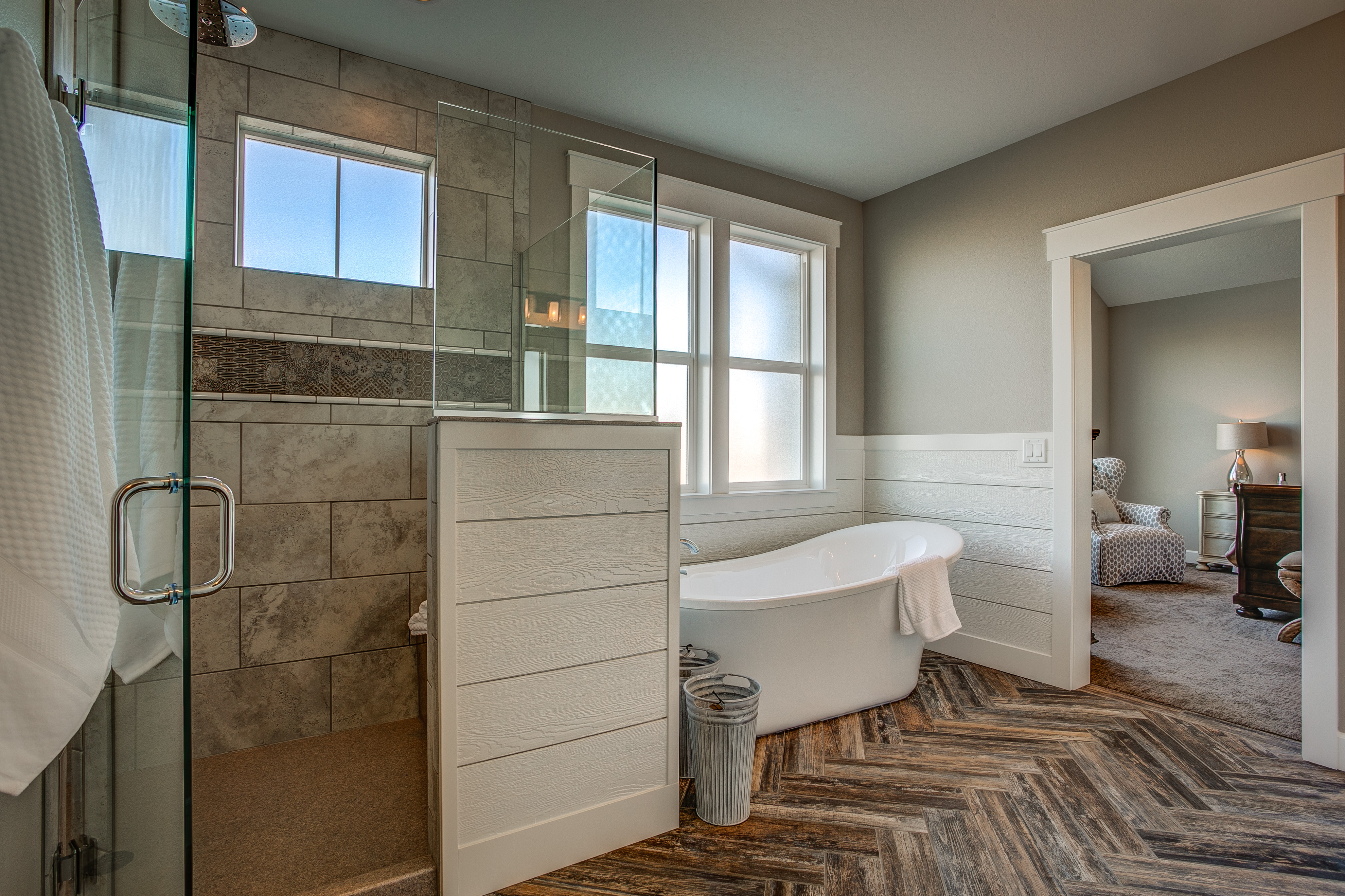 Master Bathroom Walk-in Shower with Wood plank herringbone tile floor