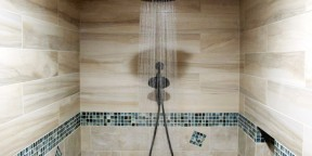 Large walk in steam shower decorative glass band border mosaic oceanside blue beach coastal tabula miele beige cream soft wood grain plank 6x36 tozen 1x1 oxygen silkl rain shower head water relaxing tranquil
