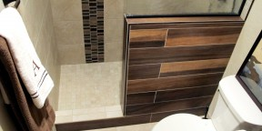 guest bathroom walk in shower shower pony wall glass stainless mosaic tile plank 6x36 Daltile Acacia Valley Ridge Kensington Beige Glazio Corrugated Series Ginger Clove